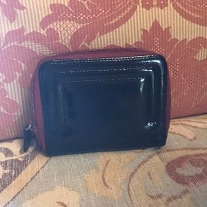 Kenneth Cole small zippered patent leather wallet.